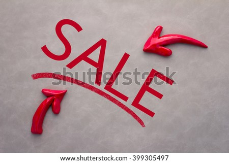 sale icon concept with red arrow and sale word on grey background business concept - stock photo