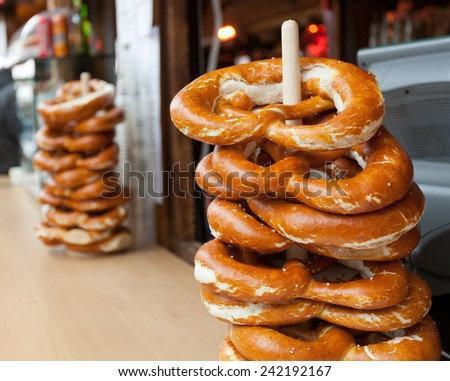 Sale of typical pretzel in a Christmas market. - stock photo