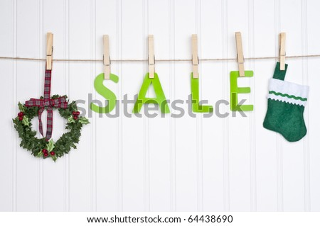 SALE on a Clothesline with a Wreath and Stocking.  Holiday Concept. - stock photo
