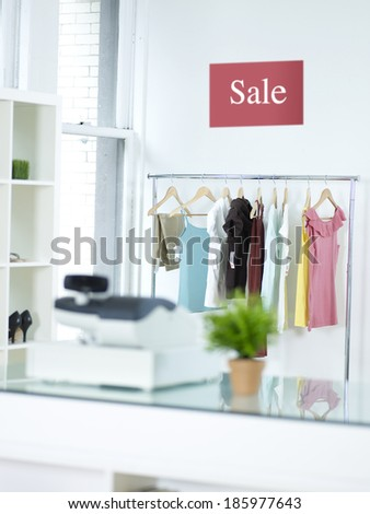 Sale Sign Above Clothes Rail - stock photo