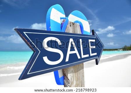 Sale  sign on the beach - stock photo