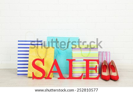 Sale with bags on floor on bright background - stock photo