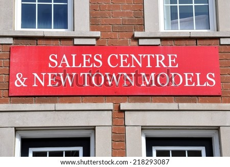 Sales centre and new town models banner - stock photo