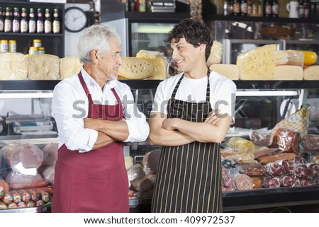 Salesmen With Arms Crossed In Cheese Shop - stock photo