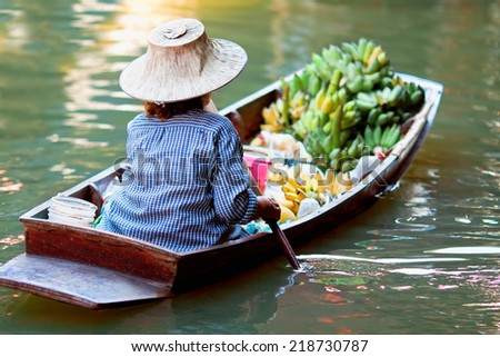 saleswoman at Floating Market Damnoen Saduak, Thailand  - stock photo