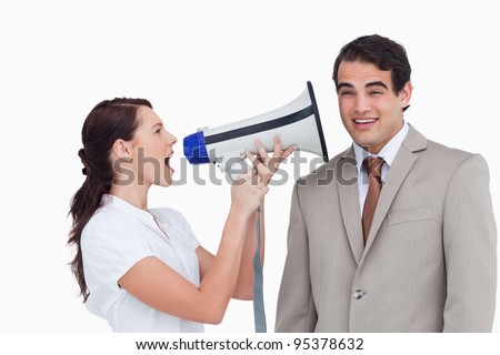 Saleswoman with megaphone yelling at colleague against a white background - stock photo