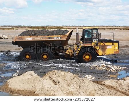 SALIN DE GIRAUD, FRANCE - JULY, 7, 2014. Construction of a  new dike in the Salt Marsh of Salin de Giraud. - stock photo