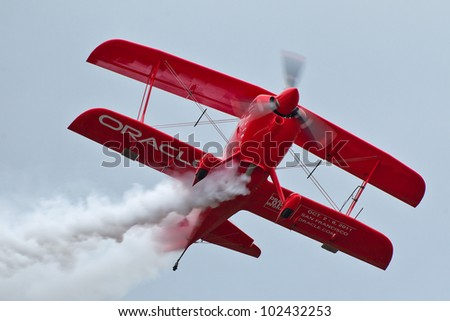 SALINAS, CA - SEPT 24: Sean D. Tucker demonstrates precision of flying and the highest level of pilot skills during the California International Airshow, on September 24, 2011, Salinas, CA. - stock photo