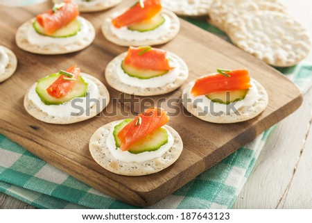 Salmon and Cracker Hor D'oeuvres with Chives and Sour Cream - stock photo