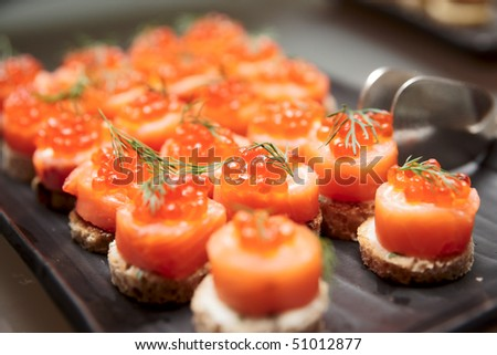 Salmon canapes, close up shot, narrow focus - stock photo
