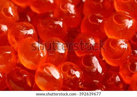 salmon caviar on a full background close-up. horizontal - stock photo