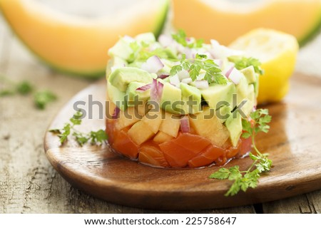 Salmon ceviche with melon, avocado and red onion - stock photo