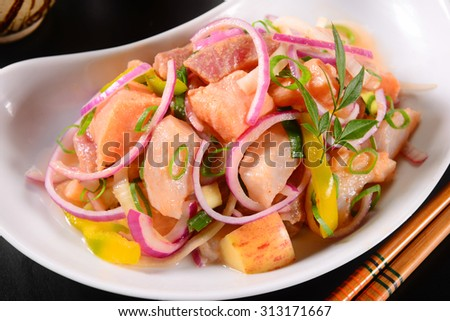Salmon ceviche with onions rigs and apple peaces - stock photo