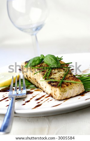 Salmon dish with chive and basil - stock photo