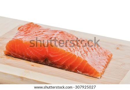 Salmon fillet on a wooden board - stock photo
