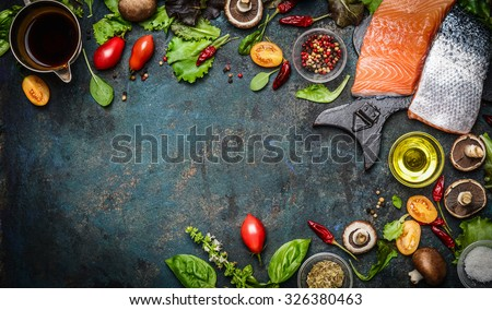 Salmon fillet with fresh ingredients for tasty cooking on rustic background, top view, banner. Healthy food concept - stock photo