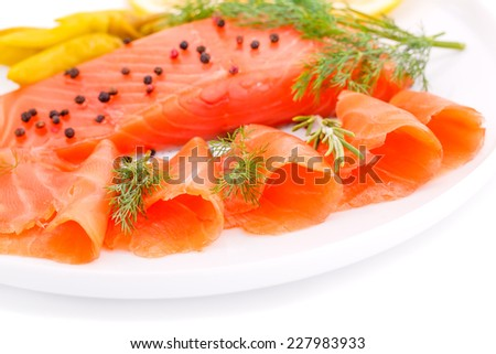 Salmon fillet with lemon, dill, pepper on plate. - stock photo