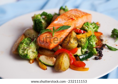 salmon fillet with vegetables and basil on a plate - stock photo