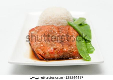 salmon fillet with white rice, snow peas and a maple soy glaze - stock photo