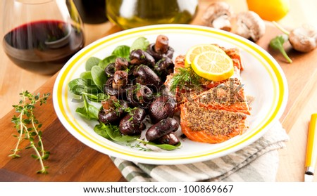 Salmon Grilled with Mustard and Served with Crimini Mushrooms Sauteed in Red Wine - stock photo