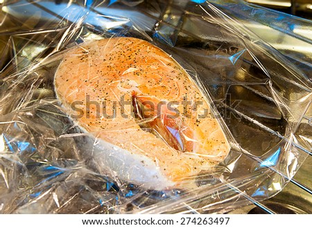 Salmon in the package for baking - stock photo