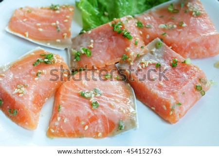 Salmon is a popular food. Classified as an oily fish, salmon is considered to be healthy due to the fish's high protein, high omega-3 fatty acids, and high vitamin content.  - stock photo