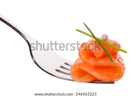 Salmon piece on fork isolated on white background cutout - stock photo