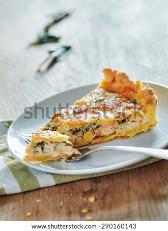 Salmon quiche with spinach - stock photo