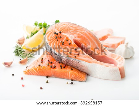 salmon raw. salmon red fish steak with herbs and lemon isolated on a white background - stock photo