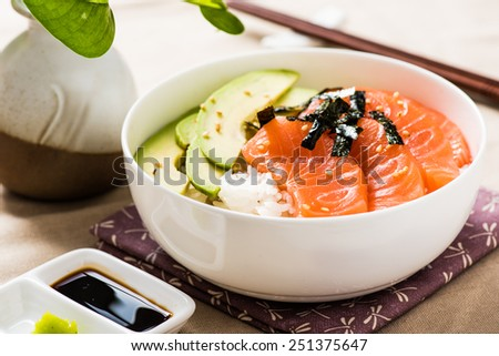 Salmon Sashimi Rice Bowl with Avocado - stock photo
