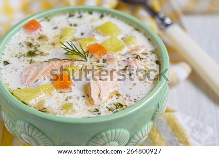 Salmon soup with cream, potatoes, carrots and dill - stock photo