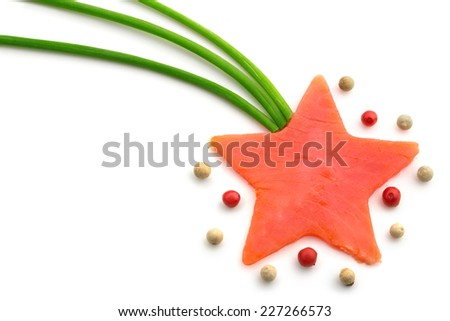 salmon star-shaped, chives and peppercorns on white background - stock photo