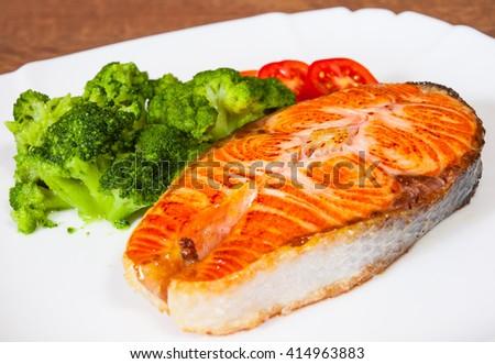 Salmon steak fish fillet with broccoli - stock photo