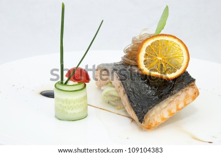 salmon steak in a restaurant and the sauce on a white background - stock photo