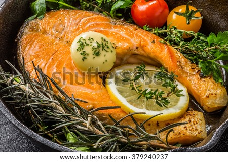 Salmon steak of the rosemary herb to make with an iron pan - stock photo