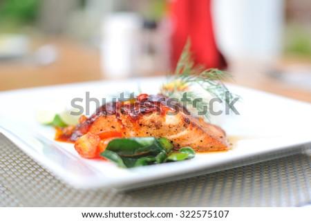 Salmon steak on dish - stock photo