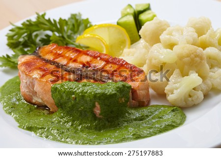 salmon steak with cauliflower - stock photo