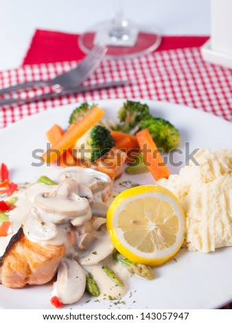 salmon steak with seafood source - stock photo