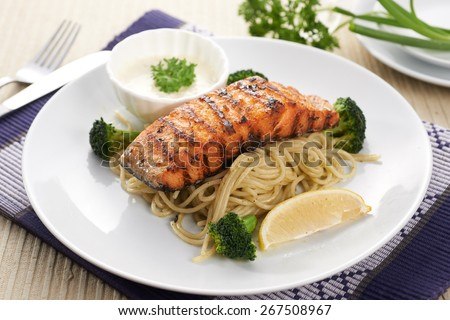 Salmon steak with spaghetti on dish - stock photo
