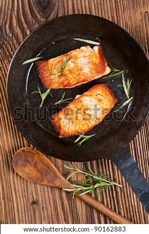 salmon steaks in the iron pan - stock photo