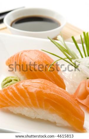 salmon sushi close up over white dish - stock photo