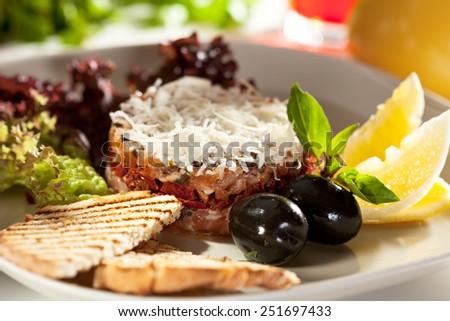 Salmon Tartare with Crispy Bread, Lemon and Salad Leaves - stock photo
