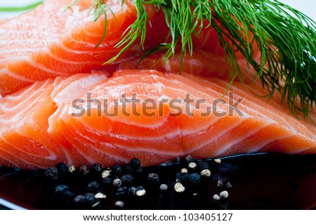 Salmon with black pepper and dill close up - stock photo