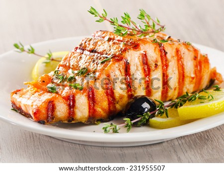 Salmon with lemon, olives and fresh thyme. Selective focus - stock photo