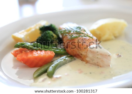salmon with lemon sauce - stock photo