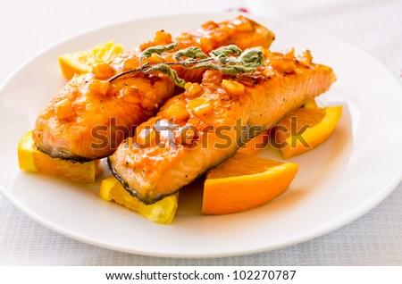 Salmon with orange and mint sauce - stock photo