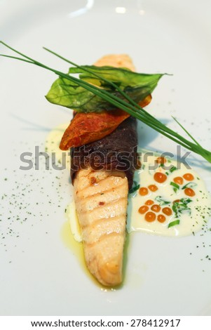Salmon with pastrami, cured spiced beef, preserve of dried meat. - stock photo