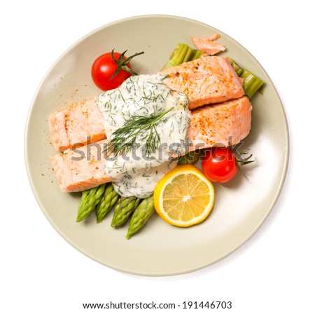 Salmon with steamed asparagus isolated top view - stock photo