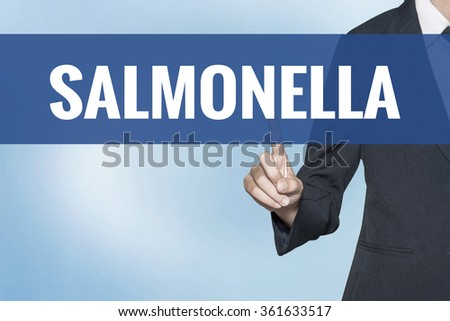 Salmonella word on virtual screen touch by business woman blue background - stock photo