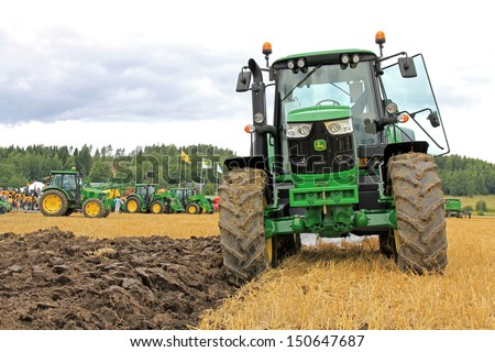 SALO, FINLAND - AUGUST 10: John Deere 6150M agricultural tractor and plow at the annual Puontin Peltopaivat Agricultural Harvesting and Ploughing Show on August 10, 2013 in Salo, Finland. - stock photo